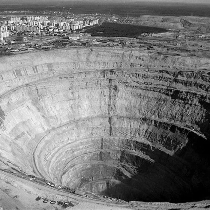 Open pit diamond mine – the largest in the world. Note city on the rim. (Mir mine, Russia)