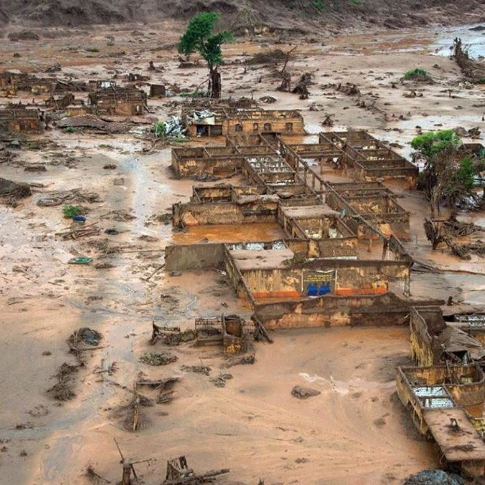Village destroyed and people killed by poisonous mud from a collapsed mine tailings dam (Mariana, Brazil)